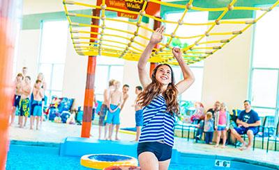 girl walking across Reeses Water Walk in pool at Hershey Lodge