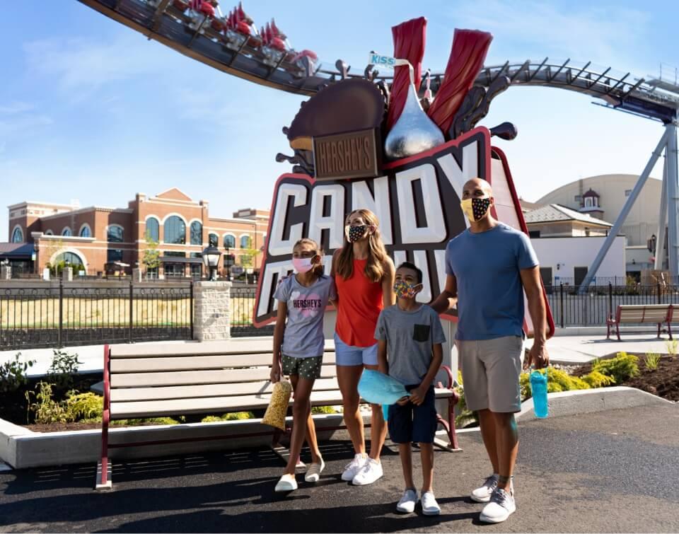 Family walking through Hershey's Chocolatetown
