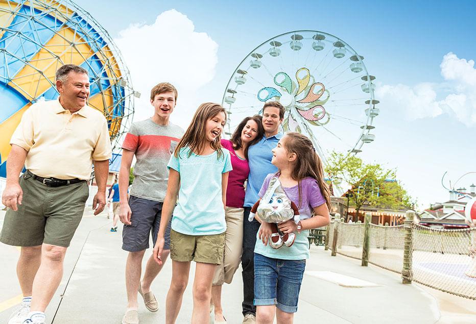 family walking around hersheypark