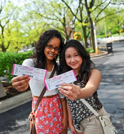 girls holding up Hersheypark Tickets