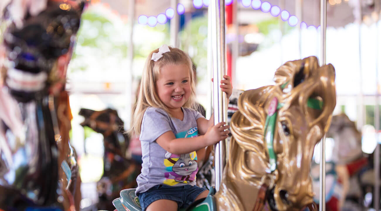 Girl Riding Carousel