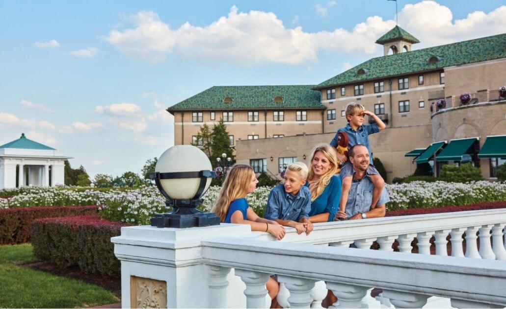 Family on the veranda at The Hotel Hershey
