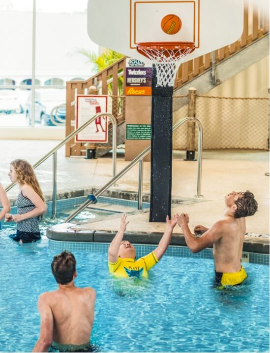 kids playing basketball in the pool